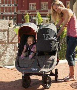 side by side double stroller with bassinet