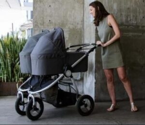 side by side double stroller with bassinet design